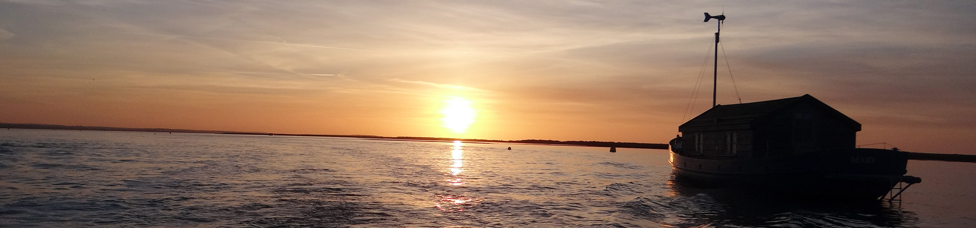 Sunset over the water at Blakaney Point