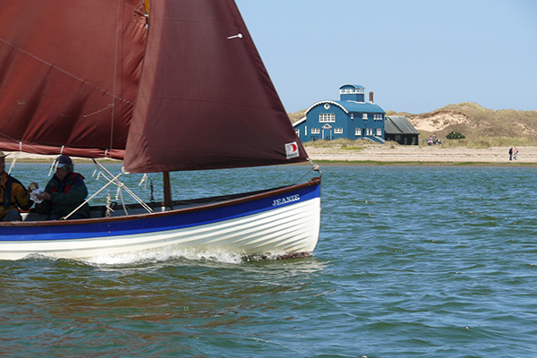 Stiffkey Cockle passing in front of the lifeboat house
